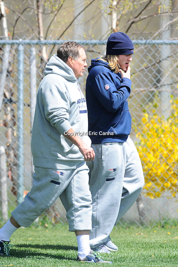 Head coach Bill Belichick walks onto the practice field with his son coaching assistant Steve Belichick at the start of the New England Patriots rookie mini camp at Gillette Stadium in Foxborough Massachusetts. Eric Canha/CSM