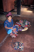 Mayan girl selling handicrafts in the Spanish colonial town of Antigua, Guatemala