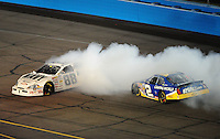 Apr 11, 2008; Avondale, AZ, USA; NASCAR Nationwide Series driver Brad Keselowski (88) spins after contact with Clint Bowyer (2) during the Bashas Supermarkets 200 at the Las Vegas Motor Speedway. Mandatory Credit: Mark J. Rebilas-