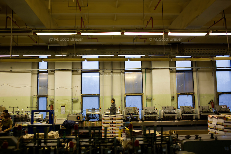A press technician inspects printing in the Moskovskii Komsomolets press in Moscow, Russia.