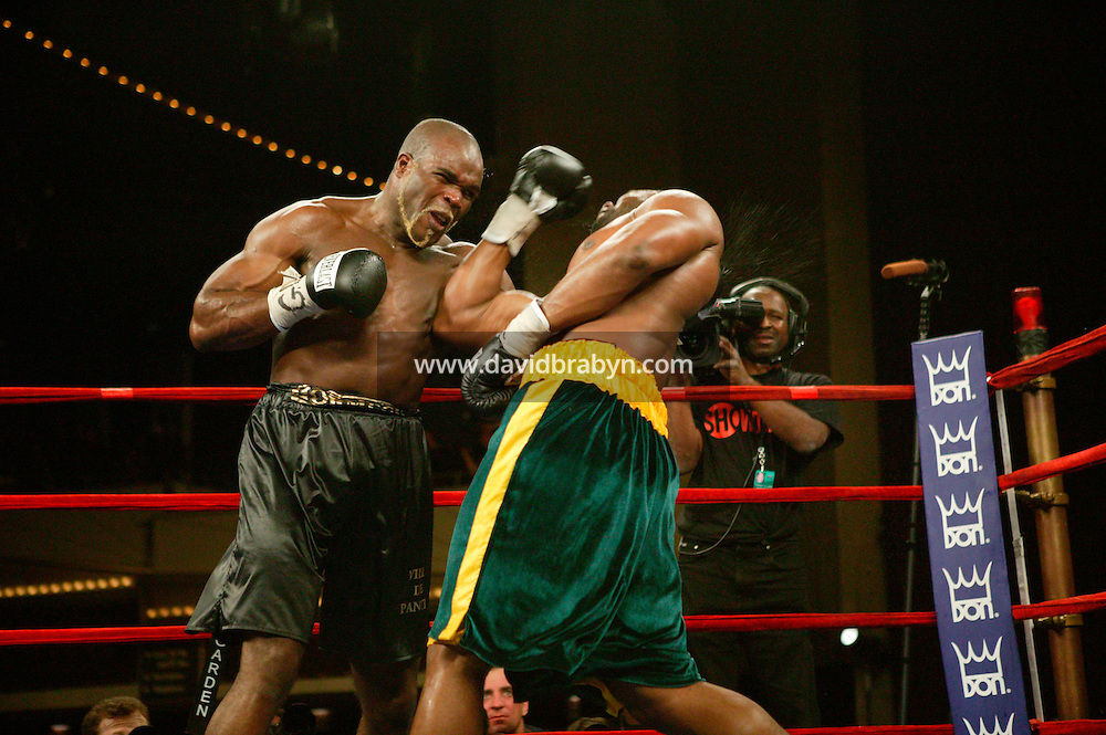 7 January 2006 - New York City, NY - Frenchman Jean-Marc Mormeck (black trunks) and Jamaican O'Neill Bell (green and yellow trunks) boxe in the World Cruiserweight Championship unification fight at Madison Square Garden in New York City, USA, 7 January 2006. O'Neil Bell won by KO in the 10th round.
