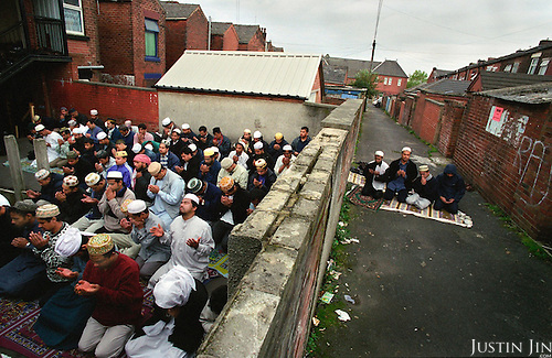 Muslims pray in Oldham, northern England..Photo by Justin Jin. November 2001, Northern England.