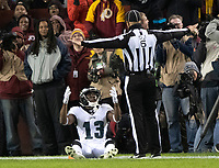Philadelphia Eagles wide receiver Nelson Agholor (13) appeals to down judge Jerod Phillips (6) who ruled his seeming reception was not a catch for a touchdown in third quarter action against the Washington Redskins at FedEx Field in Landover, Maryland on December 30, 2018. The call was reviewed and changed to a touchdown.  The Eagles won the game 24 - 0 and their victory coupled with the Viking loss allowed them to advance to the NFC playoffs. Photo Credit: Ron Sachs/CNP/AdMedia