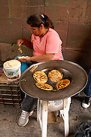 Mexican woman cooking tortillas on Canal Street in San Miguel de Allende, Mexico