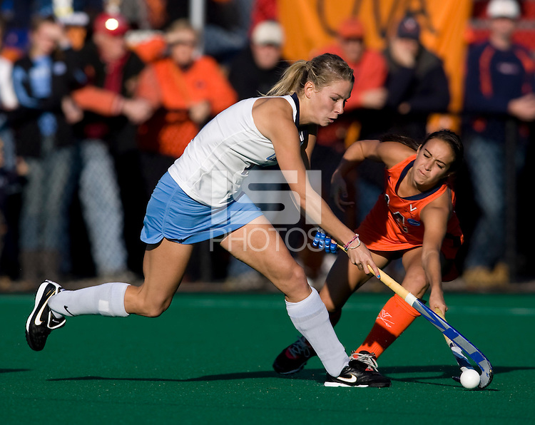 Katie Ardrey (11) of UNC keeps the ball away from Rachel Jennings (14) of Virginia during the NCAA Field Hockey Championship semfinals in College Park, MD.  North Carolina defeated Virginia, 4-3, in overtime.