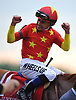 Jockey Mike Smith reacts after riding Justify to a Triple Crown win in the 150th running of the Belmont Stakes on Saturday, June 9, 2018