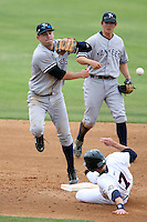 April 15, 2009:  Shortstop Addison Maruszak (59) of the Tampa Yankees, Florida State League Class-A affiliate of the New York Yankees, turns a double play as Damon Sublett backs up during a game at Space Coast Stadium in Viera, FL.  Photo by:  Mike Janes/Four Seam Images