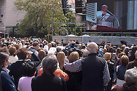 People watch on a screen the mass of Pope Francis from Vatican in a street in a street in Buenos Aires March 17, 2013. Photo by Juan Gabriel Lopera / VIEWpress.