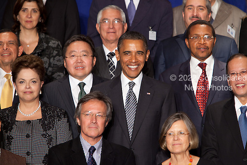 United States President Barack Obama, center, and President Dilma Rousseff of Brazil, lower left, pose for a group photo with other world leaders participating in the Open Government Partnership, a global effort to make governments better at the Waldorf-Astoria in New York, New York on Tuesday, September 20, 2011..Credit: Allan Tannenbaum / Pool via CNP