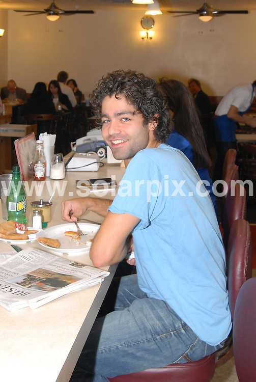 **ALL ROUND EXCLUSIVE PICTURES FROM SOLARPIX.COM**.**WORLDWIDE SYNDICATION RIGHTS**.**NO PUBLICATION IN AUSTRALIA, NEW ZEALAND,.DENMARK, GERMANY OR USA**.Adrian Grenier, the American actor, musician and director best known for his lead role on the series, Entourage, enjoys his lunch at Mickey Fine Grill in Beverly Hills. Los Angeles, California, USA. 20th October 2008..JOB REF: 7644 LAP(NB)       DATE: 20_10_2008.**MUST CREDIT SOLARPIX.COM OR DOUBLE FEE WILL BE CHARGED* *UNDER NO CIRCUMSTANCES IS THIS IMAGE TO BE REPRODUCED FOR ANY ONLINE EDITION WITHOUT PRIOR PERMISSION*