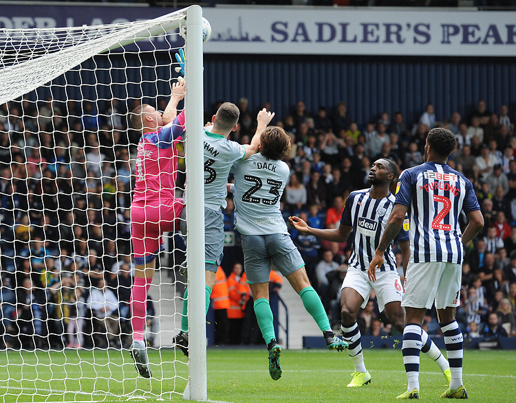 Blackburn Rovers' Darragh Lenihan and Bradley Dack challenge West Bromwich Albion's Sam Johnstone for the ball, prior to Blackburn Rovers' third goal being disallowed<br /> <br /> Photographer Kevin Barnes/CameraSport<br /> <br /> The EFL Sky Bet Championship - West Bromwich Albion v Blackburn Rovers - Saturday 31st August 2019 - The Hawthorns - West Bromwich<br /> <br /> World Copyright © 2019 CameraSport. All rights reserved. 43 Linden Ave. Countesthorpe. Leicester. England. LE8 5PG - Tel: +44 (0) 116 277 4147 - admin@camerasport.com - www.camerasport.com