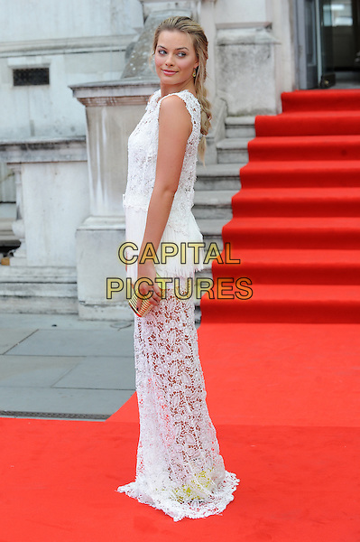 Margot Robbie <br /> attends the World Premiere of &quot;About Time&quot;, Somerset House, London, UK, 8th August 2013.<br /> full length white crochet lace sheer dress sleeveless loose hair plait braid side looking over shoulder gold clutch bag long maxi <br /> CAP/BEL<br /> &copy;Tom Belcher/Capital Pictures