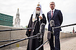 Kirill I, patriarch of the Russian Orthodox Church, left, and Moscow Mayor Sergei S. Sobyanin make statements to reporters during an appearance for Sobyanin's re-election campaign along the Moscow River embankment outside the Kremlin on Thursday, August 29, 2013 in Moscow, Russia.