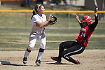Western Nevada College shortstop Melanie Pfeiffer turns a double play against Colorado Northwestern on Friday, April 6, 2012, in Carson City, Nev. The Wildcats won 5-0 and 8-0..Photo by Cathleen Allison