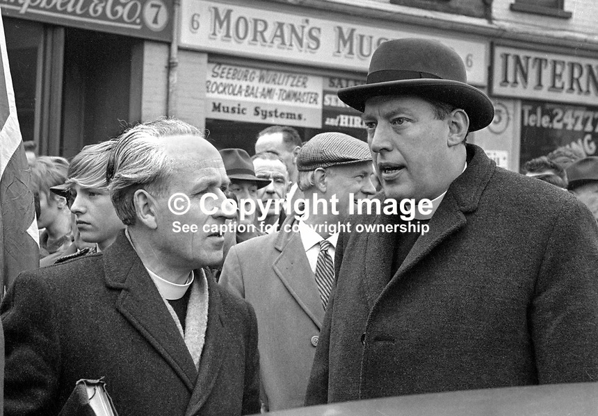 Rev Ian Paisley, Moderator, Free Presbyterian Church in Ireland, right, with an early associate, Rev John Wylie, minister of Coleraine Free Presbyterian Church at a Belfast protest rally which started at Carlisle Circus. It culminated in rioting. April 1966. 196604000002d<br />