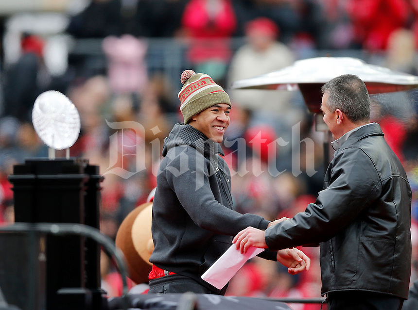 Wide receiver Evan Spencer shakes hands with head coach Urban Meyer during the Ohio State football National Championship celebration at Ohio Stadium on Saturday, January 24, 2015. (Columbus Dispatch photo by Jonathan Quilter)