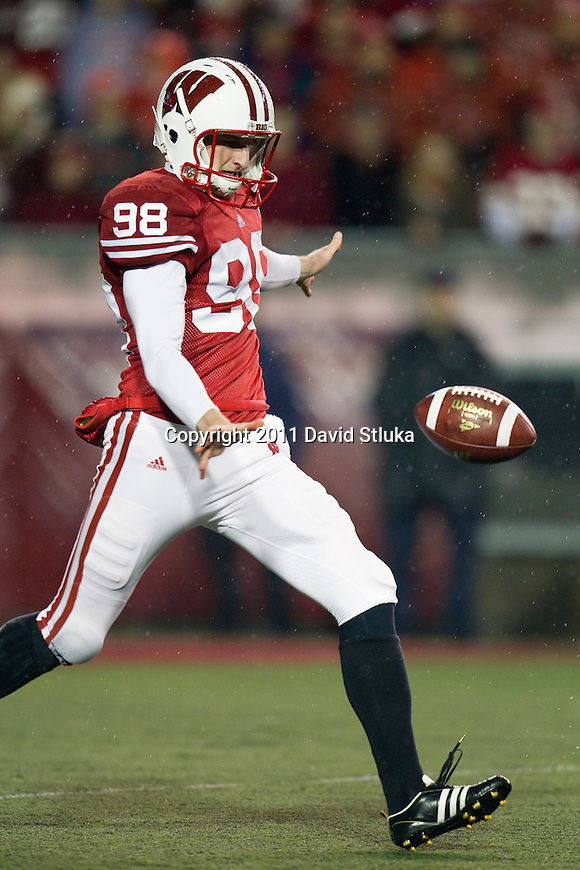 Wisconsin Badgers punter Brad Nortman (98) punts the ball during an NCAA Big Ten Conference college football game against the Penn State Nittany Lions on November 26, 2011 in Madison, Wisconsin. The Badgers won 45-7. (Photo by David Stluka)