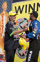 May 11, 2013; Commerce, GA, USA: NHRA pro stock driver Mike Edwards (left) congratulates top fuel dragster driver Antron Brown after winning the Southern Nationals at Atlanta Dragway. Mandatory Credit: Mark J. Rebilas-