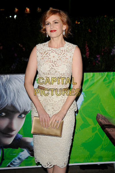 Isla Fisher.Attending the UK Premiere of 'Rise Of The Guardians', Empire Cinema, Leicester Square, London, England, UK. 15th November 2012..half length sleeveless white cream lace peplum dress clutch bag gold silk satin beige ribbon waistband .CAP/MAR.© Martin Harris/Capital Pictures.