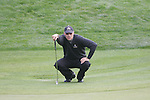 Gregory Havret's lines up his putt on the 7th hole in Friday Fourball's at the Seve Trophy on the 28th of September 2007 at the The Heritage Golf & Spa Resort, Killenard, Co Laois, Ireland. (Photo by Manus O'Reilly/NEWSFILE)