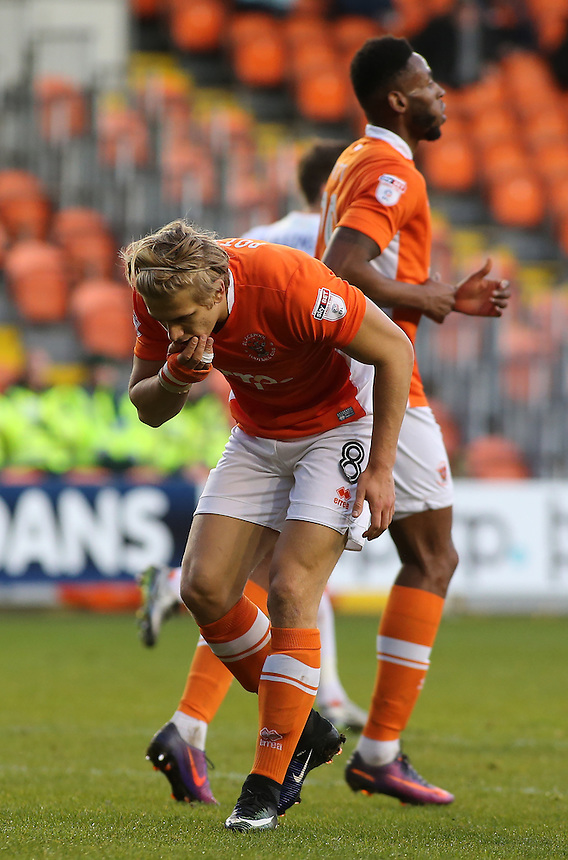 Blackpool's Brad Potts searches for his tooth after a collision with a Luton Town player<br /> <br /> Photographer David Shipman/CameraSport<br /> <br /> The EFL Sky Bet League Two - Blackpool v Luton Town - Saturday 17th December 2016 - Bloomfield Road - Blackpool<br /> <br /> World Copyright &copy; 2016 CameraSport. All rights reserved. 43 Linden Ave. Countesthorpe. Leicester. England. LE8 5PG - Tel: +44 (0) 116 277 4147 - admin@camerasport.com - www.camerasport.com