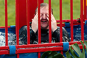 Washington, DC - June 25, 2009 -- White House Press Secretary Robert Gibbs wipes his face after being knocked into a dunk tank by members of the news media before a luau for members of Congress and their families on the South Lawn of the White House June 25, 2009 in Washington, DC. In a celebration of U.S. President Barak Obama's home state, the South Lawn was decorated with tiki torches and palm huts and the meal prepared by famous Hawaiian chef Alan Wong..Credit: Chip Somodevilla - Pool via CNP