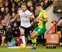Bolton Wanderers' Christian Doidge chases down Norwich City's Ben Godfrey<br /> <br /> Photographer David Shipman/CameraSport<br /> <br /> The EFL Sky Bet Championship - Norwich City v Bolton Wanderers - Saturday 8th December 2018 - Carrow Road - Norwich<br /> <br /> World Copyright &copy; 2018 CameraSport. All rights reserved. 43 Linden Ave. Countesthorpe. Leicester. England. LE8 5PG - Tel: +44 (0) 116 277 4147 - admin@camerasport.com - www.camerasport.com