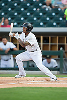 Leury Garcia (24) of the Charlotte Knights follows through on his swing against the Norfolk Tides at BB&T BallPark on July 17, 2015 in Charlotte, North Carolina.  The Knights defeated the Tides 5-4.  (Brian Westerholt/Four Seam Images)