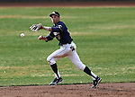 UC Davis second baseman Tino Lipson makes a leaping play in a college baseball game against University of Washington in Davis, Ca., on Saturday, Feb. 16, 2013. Davis won the opener 6-5 and dropped the second game 3-2..Photo by Cathleen Allison