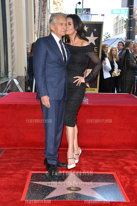 LOS ANGELES, CA. November 06, 2018: Michael Douglas &amp; Catherine Zeta-Jones at the Hollywood Walk of Fame Star Ceremony honoring actor Michael Douglas.<br /> Pictures: Paul Smith/Featureflash