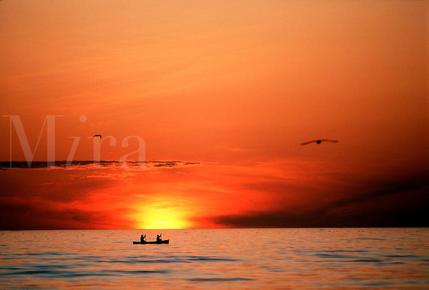 Canoeing at sunrise.