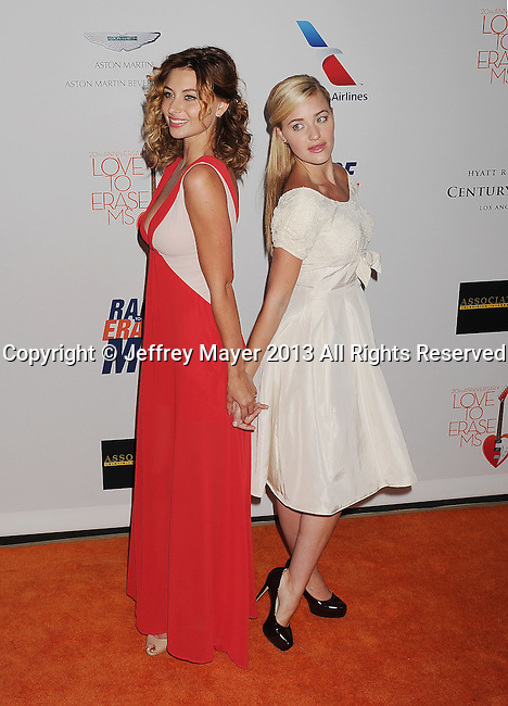 CENTURY CITY, CA- MAY 03: Actresses AJ Michalka;Aly Michalka  arrive at the 20th Annual Race To Erase MS Gala 'Love To Erase MS' at the Hyatt Regency Century Plaza on May 3, 2013 in Century City, California.