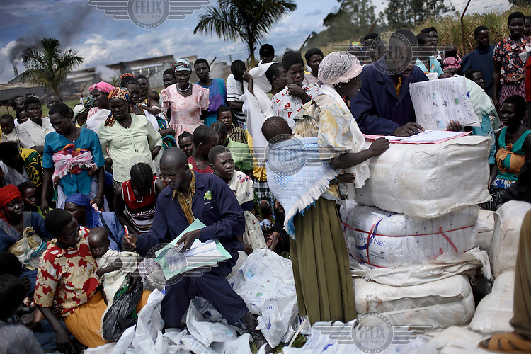 Distribution of free mosquito nets to poor families near Masindi.