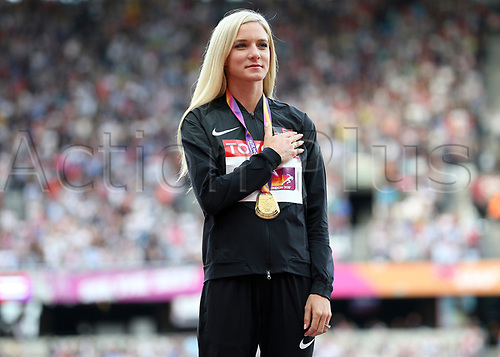 August 12th 2017, London Stadium, East London, England; IAAF World Championships, Day 9; Emma Coburn of the USA stands for the national anthem with the Gold Medal for the 3000 metres Steeplechase during the medal ceremony