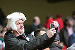 A Wales rugby fan taking a selfie.<br /> RBS 6 Nations<br /> Wales v Ireland<br /> Millennium Stadium<br /> 14.03.15<br /> &copy;Steve Pope - SPORTINGWALES