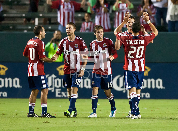 CARSON, CA – July 23, 2011: Chivas USA players Nick LaBrocca (10), Blair Gavin (18), Jorge Flores (19) and Zarek Valentin (2) celebrate Justin Braun's (17) second goal during the match between Chivas USA and Houston Dynamo at the Home Depot Center in Carson, California. Final score Chivas USA 3, Houston Dynamo 0.