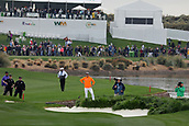 February 3rd 2019, Scottsdale, Arizona, USA;  Rickie Fowler is just off the 18th hole fairway near the rough and the water at the final round of the Waste Management Phoenix Open on February 3, 2019, at TPC Scottsdale in Scottsdale, Arizona.