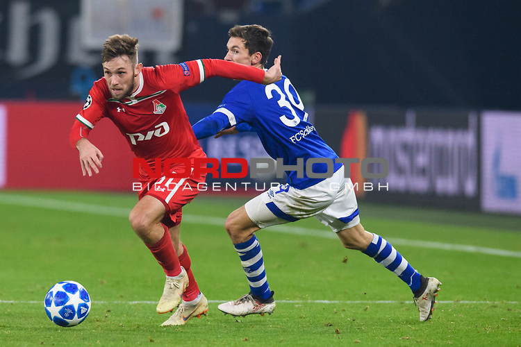 11.12.2018, VELTINS Arena, Gelsenkirchen, Deutschland, GER, UEFA Champions League, Gruppenphase, Gruppe D, FC Schalke 04 vs. FC Lokomotiv Moskva / Moskau<br /> <br /> DFL REGULATIONS PROHIBIT ANY USE OF PHOTOGRAPHS AS IMAGE SEQUENCES AND/OR QUASI-VIDEO.<br /> <br /> im Bild Zweikampf zwischen Maciej Rybus (#31 Moskau) und Benjamin Goller (#39 Schalke)<br /> <br /> Foto © nordphoto / Kurth