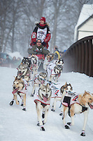 Aliyn Zirkle runs over the bridge at Chester Creek during the ceremonial start of the Iditarod sled dog race Anchorage Saturday, March 2, 2013. ..Photo (C) Jeff Schultz/IditarodPhotos.com  Do not reproduce without permission