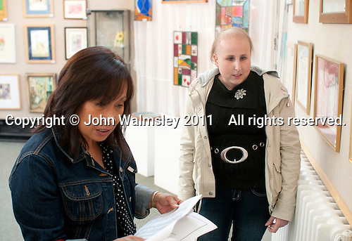 The opening of an exhibition of students' work, Harvey Gallery, Adult Learning Centre, Guildford, Surrey.