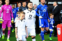 Matt Grimes of Swansea City with mascot during the Sky Bet Championship match between Swansea City and Cardiff City at the Liberty Stadium in Swansea, Wales, UK. Sunday 27 October 2019