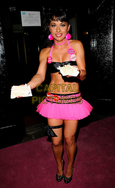 MONICA IRIMIA.The Cheeky Girls celebrate 6 years of their career with a party at Embassy club in London, England, June 10th 2008..full length pink black bra top halterneck mini skirt garter sexy badges twins sisters crop tummy midriff cake dropped .CAP/CAN.©Can Nguyen/Capital Pictures