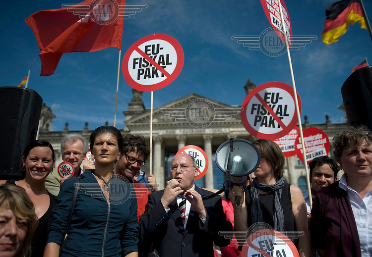 Sahra Wagenknecht, member of the left wing party Die Linke, and Gregor Gysi (centre) at a demonstration against the EU fiscal pact outside the Reichstag in Berlin. Bundestag members are set to vote on ratification of the fiscal pact and the ESM (European Stability Mechanism) inside the parliament.