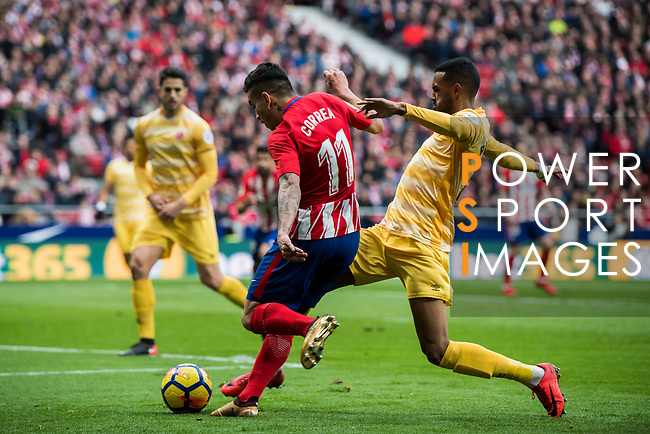 Angel Correa (L) of Atletico de Madrid fights for the ball with Jonas Ramalho Chimeno of Girona FC xduring the La Liga 2017-18 match between Atletico de Madrid and Girona FC at Wanda Metropolitano on 20 January 2018 in Madrid, Spain. Photo by Diego Gonzalez / Power Sport Images