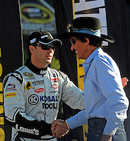 Nov. 16, 2008; Homestead, FL, USA; NASCAR Sprint Cup Series team owner Richard Petty (right) greets Jimmie Johnson prior to the Ford 400 at Homestead Miami Speedway. Mandatory Credit: Mark J. Rebilas-