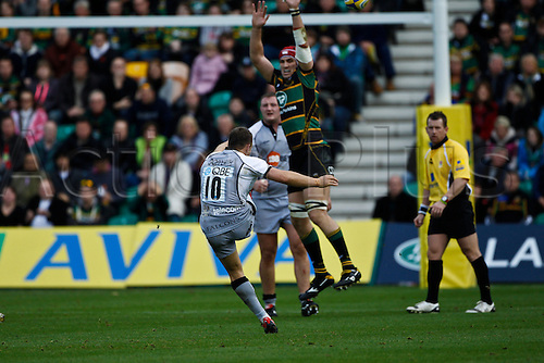 30.10.2010 Aviva Premiership Rugby Northampton Saints v Newcastle Falcons.  Newcastle's Jimmy Gopperth attempts a drop goal as Northampton's Christian Day attempts to block.