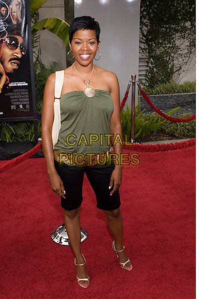 """MALINDA WILLIAMS.At the """"Hustle & Flow"""" Los Angeles Film Premiere,.held at the Arclight Cinerama Dome, .Hollywood, California, USA, 20th July 2005..full length gold circle green strapless top necklace hoop earrings  cropped trousers shorts belt.Ref: ADM.www.capitalpictures.com.sales@capitalpictures.com.©Zach Lipp/AdMedia/Capital Pictures."""