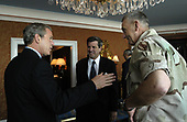 United States President George W. Bush discusses Iraqi reconstruction with Ambassador Paul Bremer, center, and General Tommy Franks in Doha, Qatar, Thursday, June 5, 2003.                            <br /> Mandatory Credit: Eric Draper / White House via CNP