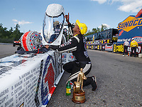 Jun 6, 2016; Epping , NH, USA; NHRA top fuel driver Antron Brown celebrates after winning the New England Nationals at New England Dragway. Mandatory Credit: Mark J. Rebilas-USA TODAY Sports