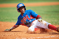 Yordany De Los Santos (4) slides into third base during the Dominican Prospect League Elite Florida Event at Pompano Beach Baseball Park on October 14, 2019 in Pompano beach, Florida.  (Mike Janes/Four Seam Images)